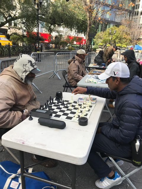 Gaj playing chess in Washington square